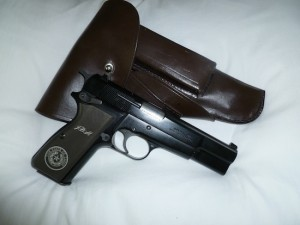 My Browning Hi-Power with custom grip and holster.